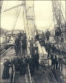 Men and one woman on the deck of an unidentified sailing vessel, Port Blakely, Washington, ca....