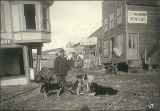 Man with six dogs, Nome, Alaska, ca. 1900.