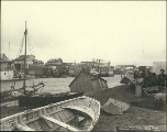 Damage done by storm to buildings and boats along the Snake River, Nome, Alaska, 1900.