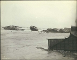 Wreckage of buildings and boats on the sand spit near the mouth of the Snake River following the...