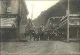 Men and women at the entrance to the Klondike Restaurant, Juneau, Alaska, ca. 1900.