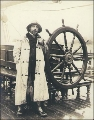 Capt. Alex Teschner beside the wheel of the three-masted German bark PERA, Port Blakely,...