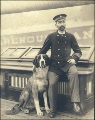 Captain Zingler with his dog on the deck of the three-masted German sailing vessel FLOTTBEK,...