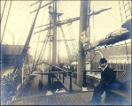 Two men on the deck of the three-masted bark KILMALLIE at dock, Puget Sound port, Washington, ca....