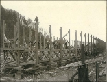 Log boom cradle under construction at Hall Brothers shipyard, Port Blakely, Washington, ca. 1900.