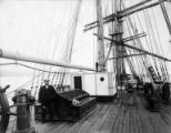 Man and dog standing on deck of unidentified ship, Washington, ca. 1900