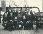 Crew and two little girls on the deck of the three-masted ship LADY ISABELLA, Puget Sound port,...