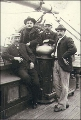 Three men and a boy on the deck of the three-masted ship FERDINAND FISCHER, Washington, ca. 1904.