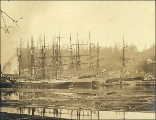 Sailing vessels docked at the Port Blakely lumber mill, Washington, ca. 1900.