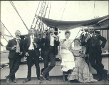 Four men and two women on the deck of the three-masted bark LAMORICIERE(?), Puget Sound port,...