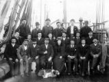 Crew of bark GLENESK seated on deck, Washington, ca. 1900