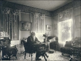 Henry Knox Hall at writing desk, probably Port Blakely, Washington, ca. 1900.