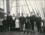 Captain Zingler and his family and friends on the deck of the three-masted German sailing vessel...