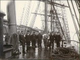 Crew  of the sailing vessel MUSKOKA standing on deck, probably Tacoma, Washington, ca. 1904.