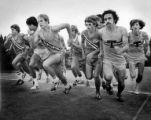 Runners sprinting from the starting line during a cross country race meet between Meadowdale,...