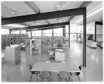 Bookshelves and reading area at North East branch of Seattle Public Library, ca. 1954