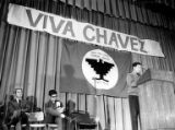 Cesar Chavez addressing a crowd during a UFW grape boycott rally in the Garfield High School...