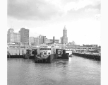 Ferry dock, Smith Tower, and downtown Seattle, n.d.