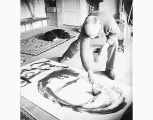 Kenneth Callahan painting in his studio, ca. 1965