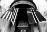 Pelican Printers (now Pelican Press) in the historic Junction Building (5200 Ballard Ave), draped...