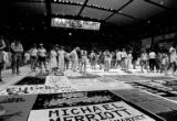 Crowd gathered around the NAMES Project AIDS memorial quilt in the Seattle Center Arena,...