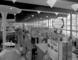 Hall of Industry interior, featuring exhibits by Johnson's Wax, United Airlines, and the National...