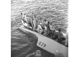 Pit crew on board hydroplane U-29, Shanty-T, at Seafair hydroplane races, Seattle, 1956