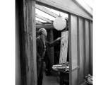 Guy Anderson painting in his studio, La Conner, ca. 1965