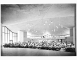 Multipurpose Building at Mercer Island High School showing students at lunch, ca. 1960