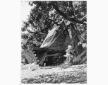 Child on swing beside Brewer cabin on Hood Canal, n.d.