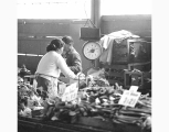 Merchants working behind vegetable stall, Pike Place Market, Seattle, ca. 1965