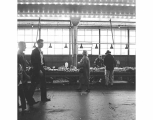 Visitors and vegetable stall, Pike Place Market, Seattle, ca. 1965