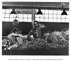 Vegetable and flower seller and stall, Pike Place Market, Seattle, July 1982