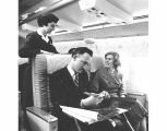 Northwest Airlines aircraft interior showing passengers and female flight attendant on , ca. 1965