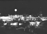 Seattle World's Fair at night, with Skyride terminus in center, Seattle, 1962