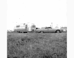 Airstream trailer and car at Airstream Rally,ca. 1962