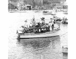 Boat on Portage Bay at Opening Day of Boating Season, Seattle, 1962