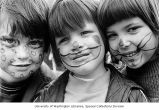 Painted faces of (from l to r) Court and Kyle Wing from the Viewridge area and Alyssa Roach of...
