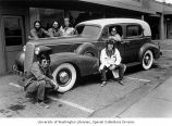 "Group of men posing with a 1937 Cadillac ""formal sedan"" at the Horseless Carriage Shop..."