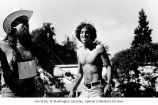 Shirtless man standing next to Jim Michels of the Seattle Air Force Kites during a kite flying...