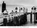 Fishermen gathered at the Edmonds Ferry Docks for summertime recreation in Edmonds, Washington,...
