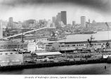 Cityscape (looking south) taken from Magnolia Bluff with Pier 91 in foreground, Seattle,...
