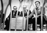 U.S. Senator Warren G. Magnuson (at left), Washington State Governor Daniel J. Evans, and another...