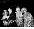 Clowns posing at the 15th Annual Christmas Cruise for handicapped students from the Fircrest...