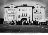 Crowd gathered in front of University Heights Elementary School in the University District,...