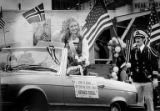 Queen Bernice Furdal from the Sons of Norway Leif Erickson Lodge waving from the back of a car...