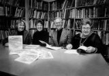 "Author Joan Swift (2nd from left) and others display copies of ""Brackett's Landing""at a..."
