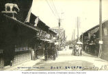 Rickshaws on business lined street, Kobe, Japan, ca. 1907
