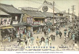 Theatre Street scene showing businesses and traffic, Yokohama, Japan, ca. 1906