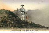 Man with walking stick and lantern on the slope of the Asama Volcano, ca. 1915